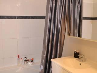 Home Staging d'une salle de bains d'enfants Après:  de style  par VALORIDOM