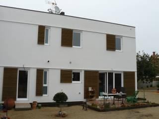 Houses by Lignea Construcció Sostenible, Modern