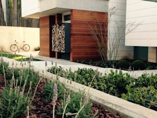 Jardines de estilo ecléctico por a.s.paisajimo