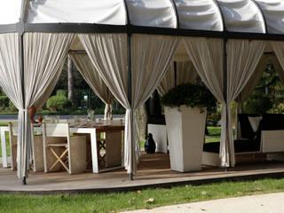 Varandas, marquises e terraços clássicas por Odue Modena - Concept Store Clássico