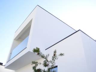 Casa da Patela: Casas  por doisarquitectos . Alexandre e Costa ,Moderno