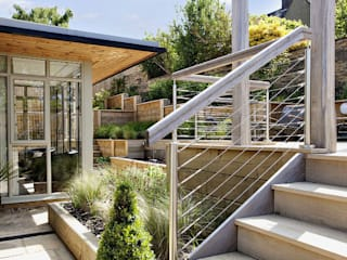 Steeply sloping garden with decked terraces by Susan Dunstall Landscape & Garden Design