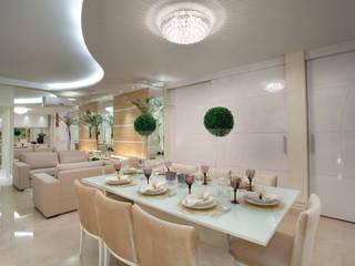 Apartamento Jatobá: Salas de jantar  por Designer de Interiores e Paisagista Iara Kílaris,