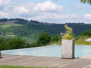 Naturpools Moderne Pools von AquaNatur GmbH Modern