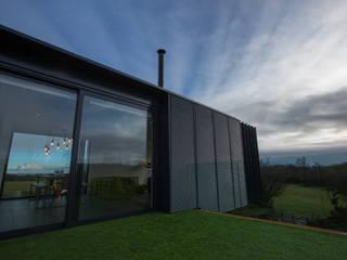 Grillagh Water من Patrick Bradley Architects حداثي