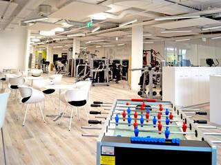 Industrial style gym by Füglistaller Architekten AG Industrial