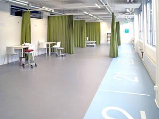 Füglistaller Architekten AG Gimnasios en casa de estilo industrial