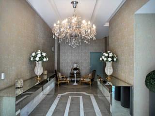 Area de Lazer do Ed. Villa Veneto da Construtora Herde.: Corredores e halls de entrada  por Gabriela Herde Arquitetura & Design