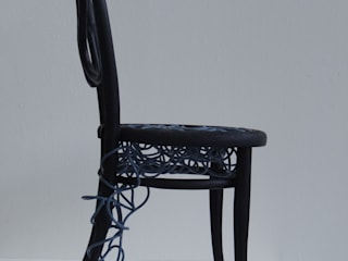 Repaired burnt Thonet chair van Robert van den Herik