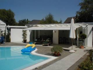 Mester Fenster-Rollladen-Markisen Mediterranean style balcony, veranda & terrace