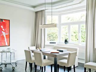 Salas de jantar modernas por dziurdziaprojekt Moderno