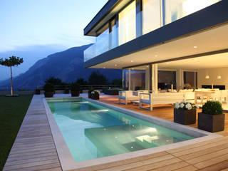 Piscinas de estilo minimalista de SCHWANDER & SUTTER Architekten Minimalista