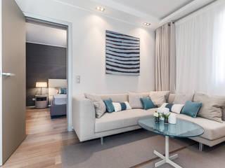 La residenza estiva - Design degli interni dell'apartamento sul Cote d'Azur: Soggiorno in stile in stile Moderno di NG-STUDIO Interior Design