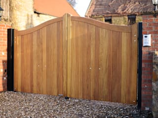 Curved top wooden gate - Idigbo hardwood:  Walls by Swan Gates
