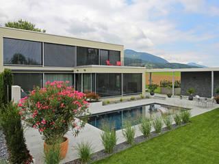 Villa mit Pool Moderne Häuser von Unica Architektur AG Modern