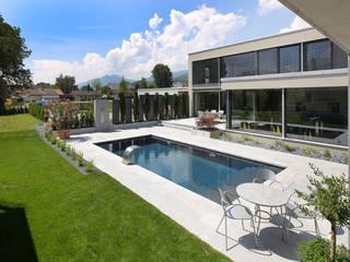 Villa mit Pool Moderne Pools von Unica Architektur AG Modern