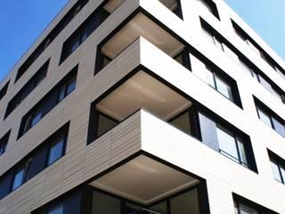Keramikfassade von Spiegel Fassadenbau: moderne Häuser von Spiegel Fassadenbau
