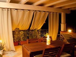 terrazzo | dopo: Terrazza in stile  di francesca ravidà    architetto | interior designer