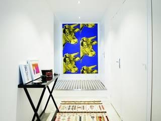 Un ancien atelier de mécanique transformé en loft d'habitation et studio de photographe par ALIOS RENOVATION Moderne