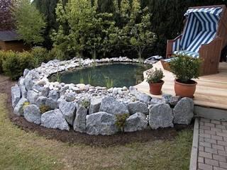 Rustic style garden by Natur-Stein-Garten Rustic
