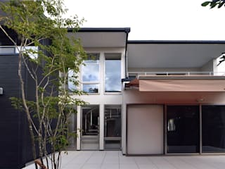 自然エネルギーを活用したエコ住宅: 川口建築設計工房が手掛けたテラス・ベランダです。,