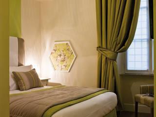 Boutique Hotel - Le Stanze di Orazio: Hotel in stile  di Arch Nouveau Studio