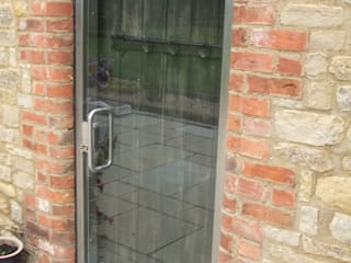 Arched top glass door for a house:  Windows  by DoorTechnik Ltd