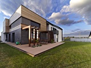 Moderne huizen van Pracownia projektowa artMOKO Modern