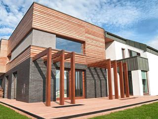 HARMONIA NOWOCZESNOŚCI: styl , w kategorii Domy zaprojektowany przez Pracownia projektowa artMOKO