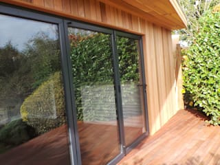 Garden Room/Cinema Room/Party Room Jardin moderne par Citi Construction & Developments Ltd Moderne