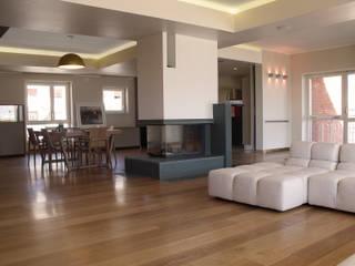 Modern living room by UAIG | Ufficio Architettura Interni Grammauta Modern