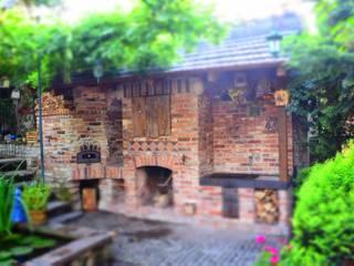 Balcone, Veranda & Terrazza in stile rustico di Kuchnia w Ogrodzie Rustico
