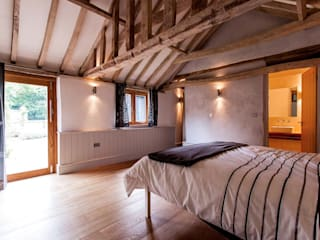 The old milking shed:  Bedroom by Beech Architects