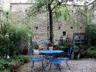 Atelier d'Ersu & Blanco Jardines de estilo moderno