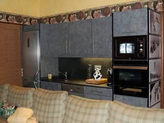 Gramil Interiorismo II - Decoradores y diseñadores de interiores ラスティックデザインの キッチン