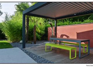 Terrasse tropicale: Jardin de style  par Gilbert Henchoz Architectes Paysagistes Associés SA
