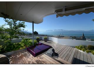 Terrasse urbaine:  de style  par Gilbert Henchoz Architectes Paysagistes Associés SA