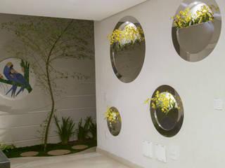 Casa Buriti: Jardins  por Arquiteto Aquiles Nícolas Kílaris
