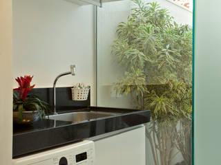 Reforma Casa Ipiranga: Jardins  por Designer de Interiores e Paisagista Iara Kílaris