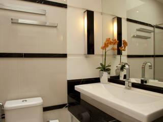 Reforma Casa Ipiranga: Banheiros  por Designer de Interiores e Paisagista Iara Kílaris
