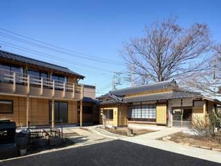 Casas clásicas de 木の家設計室 アトリエ椿 Clásico