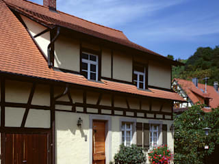 Wohnhaus 26: rustikale Häuser von Kohlbecker Gesamtplan GmbH