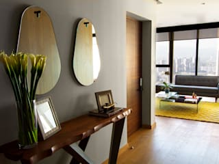 Pasillos y recibidores de estilo  por Concepto Taller de Arquitectura