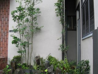 Eclectic style garden by アーテック・にしかわ/アーテック一級建築士事務所 Eclectic