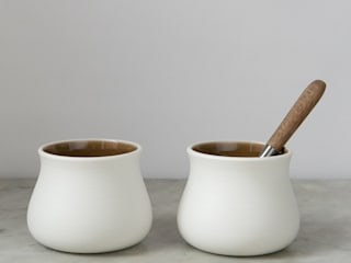 Diamond-polished porcelain curvy cups:   by Elisabeth Barry Ceramics