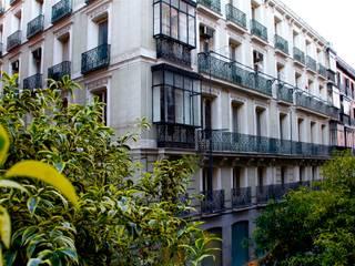 Barquillo 12, Madrid. Rehabilitación de edificio protegido para 16 viviendas y garaje robotizado Casas de estilo clásico de AURIANOVA ARQUITECTOS Clásico