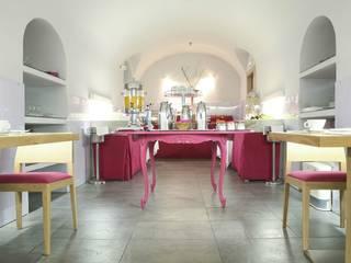 Restaurante Abovedado en color Rosa de Reformark Minimalista