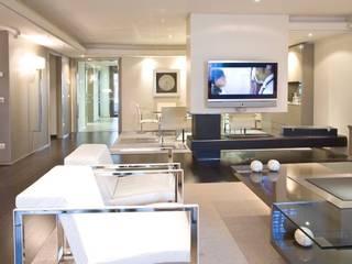 Interiorismo  y decoracion de apartamento de lujo en el centro de Granollers.:  de estilo  de Ojinaga