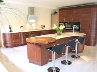 Feature breakfast bar, Hampshire: modern Kitchen by Solent Kitchen Design Ltd