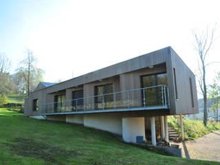 maison Sur la ville Maisons modernes par AtjM Moderne